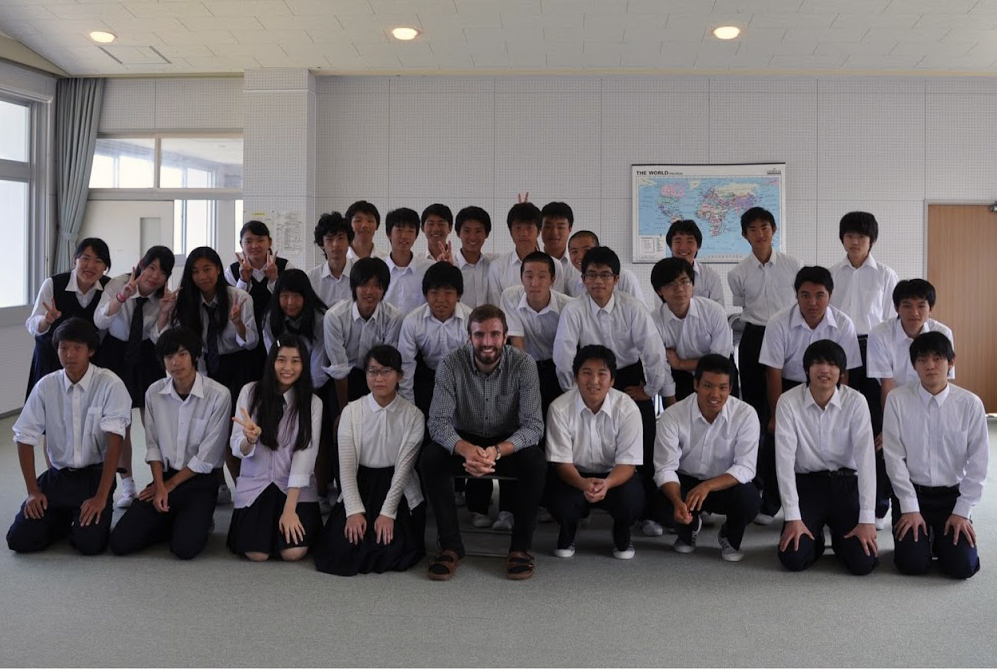 Joel Trousdale with students in Japan